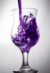 photo of a clear glass with purple liquid being poured into it - sizzurp - freedom interventions