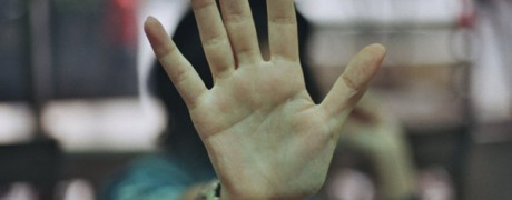 photo of the palm of a hand pushing away with head turned - when they say no - freedom interventions